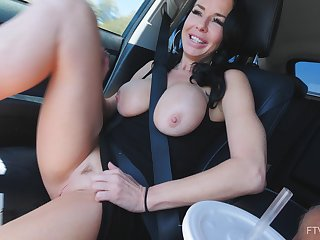Solo MILF bombshell model Veronica masturbates in a car
