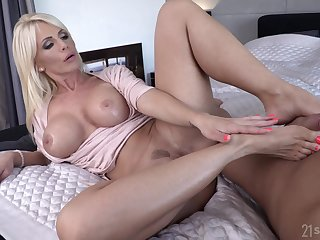 Blonde MILF bombshell Tiffany Rousso gets cum on her slender feet