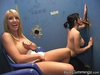 Slutty babes Barb Cummings and Gia Paloma share a glory hole cock