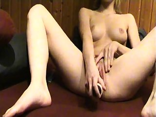 Sexy blonde chick toys wet pussy with a dildo solo
