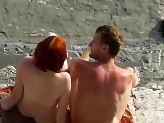 Sexy Red Haired Woman Blowjob Insusceptible to Nudist Beach