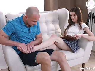 Scrumptious teen Ariana Shaine gives paralysed a progress footjob coupled with gets her muff nailed