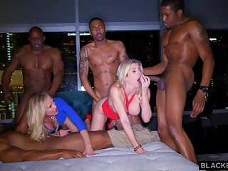 Ash-Blonde female is permanently orgying with many dark-hued boys, until she finishes all round downright weary