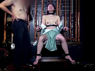 Asian Looker in BDSM Dungeon