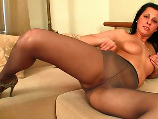 Now there's a girl that loves enervating pantyhose and she's got fine boobs