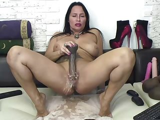MILF plays on cam with huge dildo