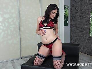 Svelte and quite leggy brunette in fishnet stockings Kizzy Sixx masturbates