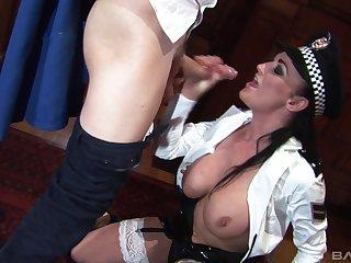 Busty MILF cop in uniform Selena Stone swallows cum