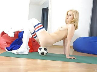 Blonde soccer babe Kyra Yorke poses provocatively in a miniskirt