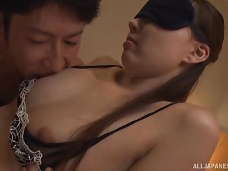 Blindfolded brunette Japanese MILF gets her mouth stuffed with cock