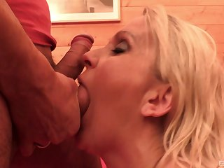 Blonde MILF Julia Pink gives a hardcore blowjob a rides in a sauna
