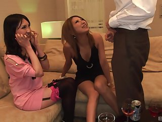 POV video of a lucky guy getting a double blowjob by Japanese babes