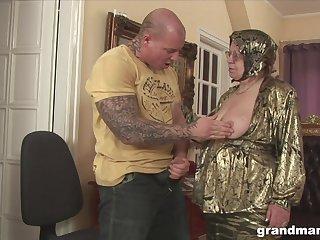 Rich granny is fucked and jizzed by huge tattooed jock